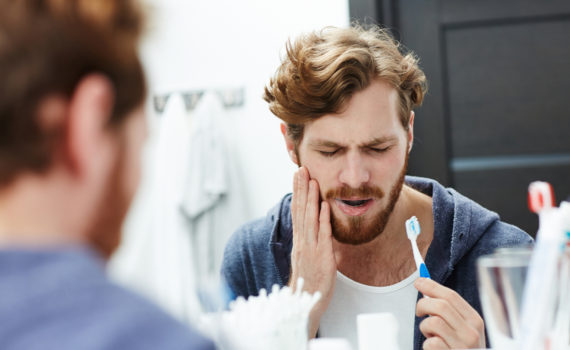 Man with sensitive teeth